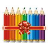 Lápices con una cinta y un arqueamiento (vector) Imágenes de archivo libres de regalías