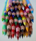 Lápices de madera coloreados sostenido fotografía de archivo