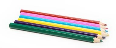 Lápices del color aislados en un blanco. Foto de archivo