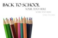 Lápices del color con de nuevo al texto de escuela Imagen de archivo libre de regalías