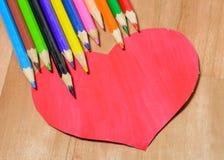 Lápices del color con el corazón Foto de archivo libre de regalías