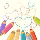 Lápices del color con los corazones. Foto de archivo libre de regalías