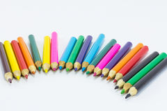 Lápices del color en el cierre blanco del fondo para arriba Fotografía de archivo libre de regalías