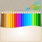 Lápices del color en el fondo de papel Foto de archivo libre de regalías