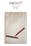 Lápices del color en el papel del grunge Fotografía de archivo