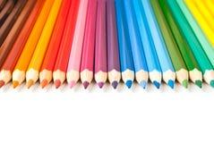 Lápices del color en fila Fotografía de archivo