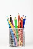 Lápices del colorante en sostenedor Imágenes de archivo libres de regalías