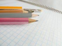 Lápices en copy-book Fotografía de archivo