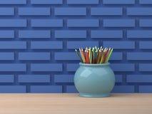 Lápices en tarro azul Imágenes de archivo libres de regalías