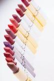 Lápices labiales en fila Fotografía de archivo