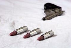 Lápices labiales en la cama Imagen de archivo libre de regalías