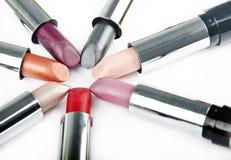 Lápices labiales en redondo Foto de archivo libre de regalías