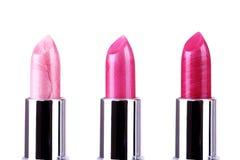 Lápices labiales rosados en blanco Fotografía de archivo libre de regalías