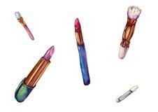 Lápices labiales y cepillos Fotos de archivo