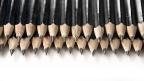 Lápices negros en fila Fotos de archivo