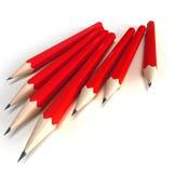 Lápices rojos con extremidad negra ilustración del vector
