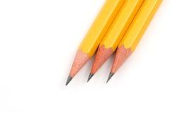 Lápices sostenidos sobre blanco Imagenes de archivo
