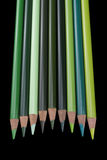 9 lápices verdes - fondo negro Imagen de archivo