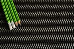 Lápices verdes y negros de la escritura Fotos de archivo libres de regalías