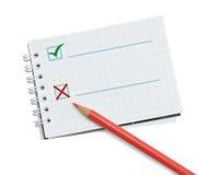 Lápices y cuaderno rojos Foto de archivo libre de regalías