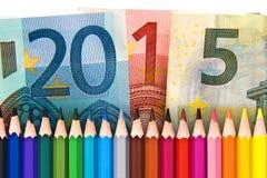 Lápices y euros de madera, de nuevo a la escuela 2015 foto de archivo
