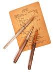 Lápices y papel de la vendimia Fotos de archivo libres de regalías