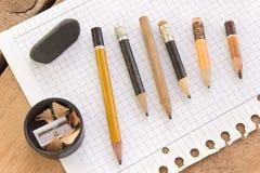 Lápices y papel usados Imágenes de archivo libres de regalías