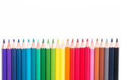 Lápices y pedazos de madera coloreados Foto de archivo libre de regalías