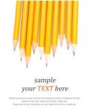 Lápices y texto agudos de madera Foto de archivo