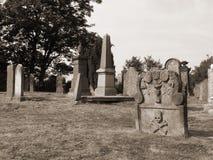 Lápida mortuaria vieja en sepia Fotografía de archivo