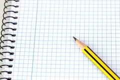 Lápis afiado em um caderno espiral Fotos de Stock