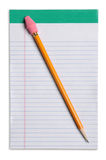 Lápis amarelo sobre a almofada de nota Imagem de Stock Royalty Free