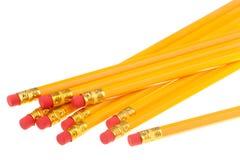 Lápis amarelos com eliminadores Imagem de Stock Royalty Free