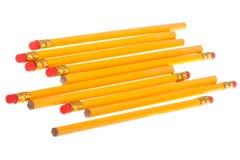 Lápis amarelos com eliminadores Fotografia de Stock