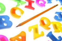 Lápis & alfabeto Fotografia de Stock