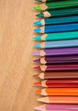 Lápis coloridos arranjados em seguido Fotos de Stock Royalty Free