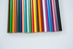 Lápis coloridos arranjados em seguido Imagens de Stock