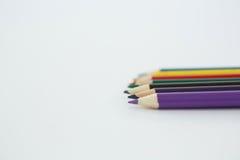 Lápis coloridos arranjados em seguido Imagem de Stock