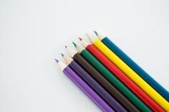 Lápis coloridos arranjados em seguido Fotografia de Stock Royalty Free