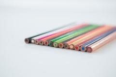 Lápis coloridos arranjados em seguido Foto de Stock