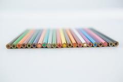 Lápis coloridos arranjados em seguido Imagem de Stock Royalty Free