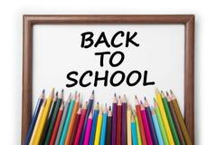 Lápis coloridos com quadro no fundo branco Imagem de Stock