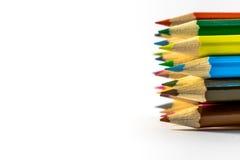 Lápis coloridos das fontes de escola em seguido Imagens de Stock Royalty Free
