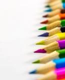 Lápis coloridos das fontes de escola em seguido Fotografia de Stock