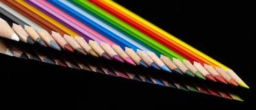 Lápis coloridos em seguido Fotografia de Stock Royalty Free