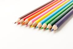 Lápis coloridos em um ângulo Foto de Stock Royalty Free