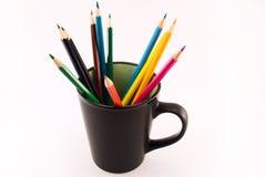lápis coloridos em um copo Fotografia de Stock