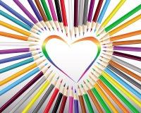 Lápis coloridos em um coração Imagens de Stock