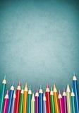 Lápis coloridos em um fundo da textura Imagem de Stock