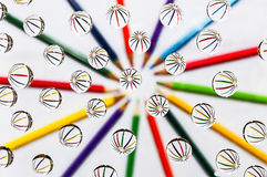 Lápis coloridos, gotas da água Imagem de Stock Royalty Free